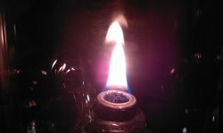A close-up macro mode in low light, surprisingly nice (the candle is surrounded by glass so no flash even)